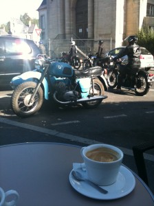 Coffee on a table near a Jupiter motorcycle combo
